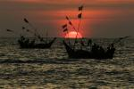 Fishing boats are seen against setting sun on Maungmagan beach near the town of Dawei in southern Myanmar November 19, 2011. Picture taken November 19, 2011. As the former British colony embarks on its most dramatic changes since the military took power in what was then known as Burma in a 1962 coup, mega-projects like the 250 sq km (97 sq mi) Dawei Special Economic Zone hint at even more significant changes ahead. Major road and rail routes from the industrial zone, built by Thailand's biggest construction company, Italian-Thai Development Plc, link Dawei's port to China, India and Southeast Asia, creating a new trading route that will allow Southeast Asia to capitalize on its proximity to booming China and India. To match Insight MYANMAR/REFORMS    REUTERS/Staff (MYANMAR - Tags: SOCIETY BUSINESS TPX IMAGES OF THE DAY)