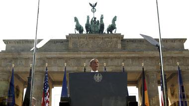 From behind a bullet-proof glass, President Barack Obama speaks in front of the Brandenburg Gate in Berlin, Germany June 19, 2013. REUTERS/Kevin Lamarque