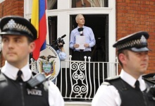 WikiLeaks founder Julian Assange speaks to the media outside the Ecuador embassy in west London August 19, 2012. Assange used the balcony of Ecuador's London embassy on Sunday to berate the United States for threatening freedom of expression and called on U.S. President Barack Obama to end what he called a witch-hunt against WikiLeaks. REUTERS/Olivia Harris (BRITAIN - Tags: POLITICS CRIME LAW MEDIA)