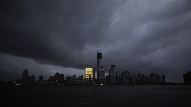A general view from Exchange Place shows the skyline of lower Manhattan in darkness after a preventive power outage caused by giant storm Sandy in New York October 30, 2012. REUTERS/Eduardo Munoz