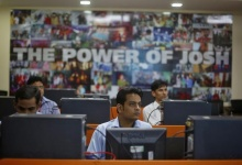 Newly recruited employees attend a training session inside Tech Mahindra office building in Noida on the outskirts of New Delhi March 18, 2013. REUTERS/Adnan Abidi