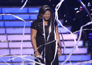 Finalist Candice Glover reacts following her performance after being announced the winner during the Season 12 finale of American Idol in Los Angeles May 16, 2013. Glover, a soul singer from rural South Carolina, was named &quot;American Idol&quot; on Thursday, becoming the first female singer to win the television singing competition since 2007. REUTERS/Phil McCarten 