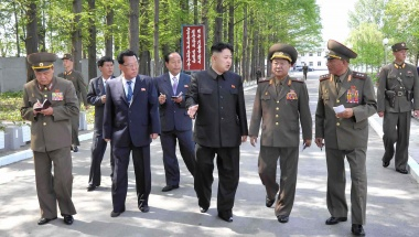 North Korean leader Kim Jong-un (C) visits the &quot;February 20 factory of the Korean People's Army&quot; in this photo released by North Korea's Central News Agency on May 17, 2013.  REUTERS/KCNA 