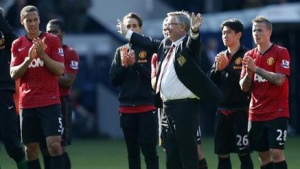 Manchester United manager Alex Ferguson salutes the fans after their English Premier League soccer match against West Bromwich Albion at The Hawthorns in West Bromwich, central England, May 19, 2013. REUTERS/Eddie Keogh