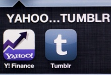 A photo illustration shows the applications of Yahoo and Tumblr on the screen of an iPhone in Zagreb May 20, 2013. REUTERS/Antonio Bronic