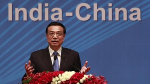 Chinese Premier Li Keqiang gestures as he addresses a gathering during a business summit in Mumbai May 21, 2013. Li is in India on a three-day state visit. REUTERS/Danish Siddiqui