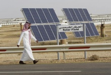 A Saudi man walks on a street past a field of solar panels at the King Abdulaziz city of Sciences and Technology, Al-Oyeynah Research Station, May 21, 2012.  REUTERS/Fahad Shadeed