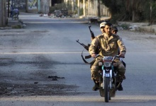 Free Syrian Army fighters travel on a motorcycle in Deir al-Zor May 16, 2013. Picture taken May 16, 2013. REUTERS/Khalil Ashawi