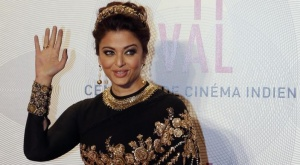 Indian actress Aishwarya Rai poses as she arrives at the evening's gala of the film &quot;Bombay Talkies&quot; celebrating a hundred years of Indian cinema, during the 66th Cannes Film Festival in Cannes May 19, 2013. REUTERS/Eric Gaillard