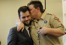 Jennifer Tyrrell who was removed from her position as a den leader in 2012 for being gay, kisses Zach Wahls (L), executive director of Scouts for Equality, a pro gay group, after a resolution passed to allow openly gay scouts in the Boy Scouts of America at the Boy Scouts' National Annual Meeting in Grapevine, Texas May 23, 2013. REUTERS/Michael Prengler