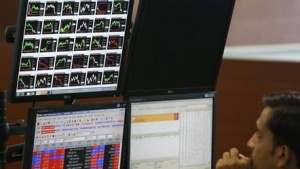 A broker monitors a screen displaying live stock quotes on the floor of a trading firm in Mumbai May 23, 2013. REUTERS/Vivek Prakash