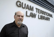 Steve Levin poses at the entrance of Guam Territorial Law Library in Hagatna, Guam March 19, 2013. REUTERS/Victor Consaga