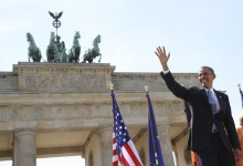 U.S. President Barack Obama waves as he arrives to give a speech in front of the Brandenburg Gate at Pariser Platz in Berlin June 19, 2013. REUTERS/Michael Kappeler/Pool