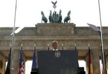 From behind bulletproof glass, President Obama speaks in front of the Brandenburg Gate in Berlin, Germany on June 19th, 2013. REUTERS/Kevin Lamarque