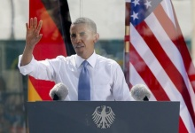 U.S. President Barack Obama speaks from behind a bulletproof glass at the Brandenburg Gate in Berlin, June 19, 2013.   REUTERS/Fabrizio Bensch