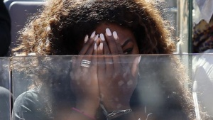 Serena Williams covers her face as she looks on during the women's singles match between her sister Venus Williams of the U.S. and Laura Robson of Britain at the Rome Masters tennis tournament May 13, 2013. REUTERS/Alessandro Bianchi