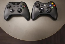 The new Xbox One controller (R), next to the previous controller during a press event unveiling Microsoft's new Xbox One in Redmond, Washington May 21, 2013. REUTERS/Nick Adams/Files