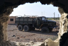 An abandoned military truck belonging to forces loyal to President Bashar Al-Assad is seen after what activists said where clashes between the Free Syrian Army and forces loyal to President Bashar Al-Assad in Raqqa province, eastern Syria June 16, 2013. REUTERS/Nour Fourat