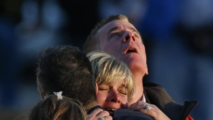 Lynn and Christopher McDonnell, the parents of seven-year-old Grace McDonnell, grieve near Sandy Hook Elementary after learning their daughter was one of 20 school children and six adults killed after a gunman opened fire inside the school in Newtown, Connecticut on December 14, 2012.  A heavily armed gunman opened fire on school children and staff at a Connecticut elementary school on Friday, killing at least 26 people, including 20 children, in the latest in a series of shooting rampages that have tormented the United States this year.     REUTERS/Adrees Latif   (UNITED STATES - Tags: CRIME LAW EDUCATION TPX IMAGES OF THE DAY) - RTR3BKZQ