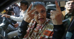 Delhi's Chief Minister Sheila Dikshit gestures as she shows her ink-marked finger after casting her vote at a polling station during the state assembly elections in New Delhi December 4, 2013. REUTERS/Anindito Mukherjee