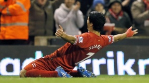 Liverpool's Luis Suarez celebrates scoring a goal against Norwich City during their English Premier League soccer match at Anfield in Liverpool, northern England December 4, 2013. REUTERS/Phil Noble