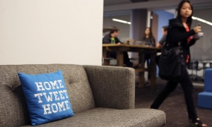 A pillow is placed on a couch at Twitter headquarters in San Francisco, California October 4, 2013. REUTERS/Robert Galbraith/Files