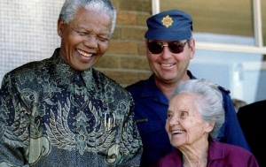 Betsie Verwoerd (R), the widow of former Prime Minister Hendrik Verwoerd, the assassinated architect of apartheid, stands with former South African President Nelson Mandela in this 1995 file photo. REUTERS/Files