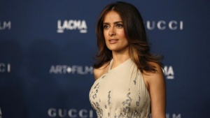 Actress Salma Hayek poses at the Los Angeles County Museum of Art (LACMA) 2013 Art+Film Gala in Los Angeles, California November 2, 2013.   REUTERS/Mario Anzuoni/Files