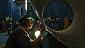 An employee works on the production line inside the heavy electrical manufacturing unit of Larsen & Turbo in Mumbai December 4, 2013. REUTERS/Mansi Thapliyal