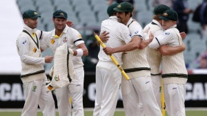 Australia's captain Michael Clarke (L) and Ryan Harris (2nd L) celebrate with team mates after winning the second Ashes cricket test against England at the Adelaide Oval December 9, 2013. REUTERS/David Gray