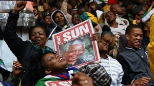 People sing and dance at the First National Bank (FNB) Stadium, also known as Soccer City, ahead of former South Africa's President Nelson Mandela's national memorial service in Johannesburg December 10, 2013. REUTERS/Yves Herman