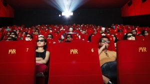 Cinema-goers wearing 3D glasses watch a movie at a PVR Multiplex in Mumbai November 10, 2013. REUTERS/Danish Siddiqui/Files
