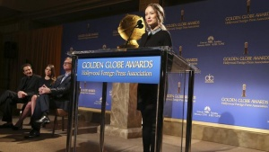 Actress Olivia Wilde speaks at the podium during the announcement of nominations for the 71st annual Golden Globe Awards in Beverly Hills, California December 12, 2013. REUTERS/Jonathan Alcorn