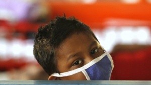 A boy who is a cancer patient rests inside the children's ward at the Cancer Centre Welfare Home and Research Institute in Kolkata March 16, 2012. REUTERS/Rupak De Chowdhuri/Files
