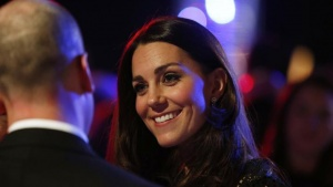 Britain's Catherine, Duchess of Cambridge, patron of SportsAid charity, interacts during the charity's annual gala dinner SportsBall in London, November 28, 2013. REUTERS/Lefteris Pitarakis/Pool/Files