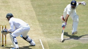 M Rahane (R) avoids being run out by South Africa's AB de Villiers during the fourth day of their cricket test match in Johannesburg December 21, 2013. REUTERS/Ihsaan Haffejee