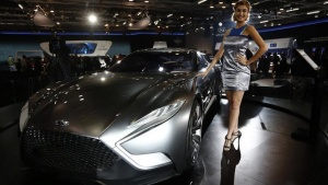A model stands next to a Hyundai HND-9 Venace concept car during the Indian Auto Expo in Greater Noida on the outskirts of New Delhi, February 5, 2014. REUTERS/Adnan Abidi