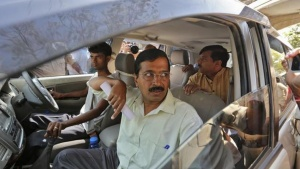 Delhi's former chief minister and the chief of the Aam Aadmi (Common Man) Party (AAP) Arvind Kejriwal arrives to address a news conference on the outskirts of Ahmedabad March 7, 2014. REUTERS/Amit Dave