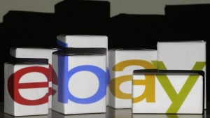 An eBay logo is projected onto white boxes in this illustration picture taken in Warsaw, January 21, 2014. REUTERS