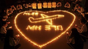 International school students light candles to pray for passengers aboard Malaysia Airlines flight MH370, in Zhuji, Zhejiang province, March 10, 2014. REUTERS/Stringer