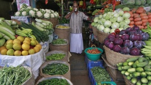 A vendor drinks tea at his stall in a wholesale vegetable market, in Kochi January 15, 2014. REUTERS/Sivaram V/Files