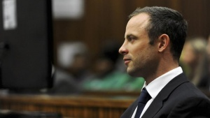 Olympic and Paralympic track star Oscar Pistorius sits in the dock during court proceedings at the North Gauteng High Court in Pretoria March 12, 2014. Werner Beukes/Pool