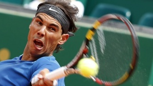 Rafael Nadal of Spain returns the ball to Teymuraz Gabashvili of Russia during the Monte Carlo Masters in Monaco April 16, 2014. REUTERS/Eric Gaillard