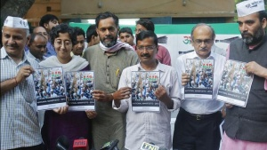 Delhi's former chief minister and Aam Aadmi Party (AAP) chief Arvind Kejriwal (C), accompanied by his other party members, hold their party's manifesto ahead of the general election in New Delhi April 3, 2014. REUTERS/Anindito Mukherjee