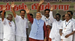 Narendra Modi (C), the prime ministerial candidate for India's main opposition Bharatiya Janata Party (BJP) and Gujarat's chief minister, waves to his supporters during a public meeting at Krishnagiri in Tamil Nadu April 16, 2014. REUTERS/Babu