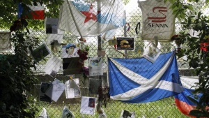 Handwritten notes and flags left by fans are pictured near the memorial statue of Brazilian Formula One driver Ayrton Senna at the race track in Imola April 22, 2014. REUTERS/Alessandro Garofal