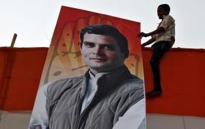 A boy holds a poster of Rahul Gandhi in Kolkata May 8, 2014. REUTERS/Rupak De Chowdhuri