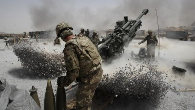 U.S. Army soldiers from the 2nd Platoon, B battery 2-8 field artillery, fire a howitzer artillery piece at Seprwan Ghar forward fire base in Panjwai district, Kandahar province southern Afghanistan, June 12, 2011. REUTERS/Baz Ratner