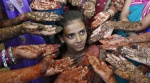 Schoolchildren show their hands decorated with henna paste during a henna competition to mark World Population Day in Ahmedabad July 11, 2014. REUTERS/Amit Dave