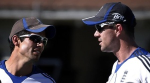 England cricket team captain Alastair Cook (L) talks with teammate Kevin Pietersen during a team training session at the Basin Reserve in Wellington March 12, 2013. REUTERS/David Gray/Files